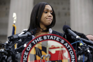 Marilyn Mosby, Baltimore state's attorney, pauses while speaking during a media availability, Friday, May 1, 2015 in Baltimore. Mosby announced criminal charges against all six officers suspended after Freddie Gray suffered a fatal spinal injury while in police custody. (AP Photo/Alex Brandon)